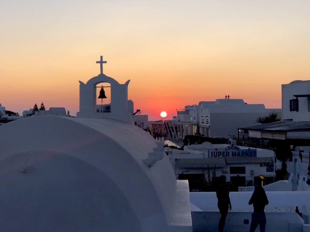 Watching the sun set in Santorini is a MUST!