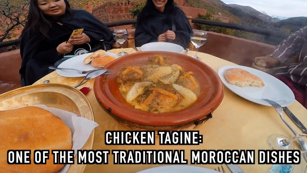 Moroccan chicken tagine is slow cooked in a ceramic pot with dried fruit and served with bread