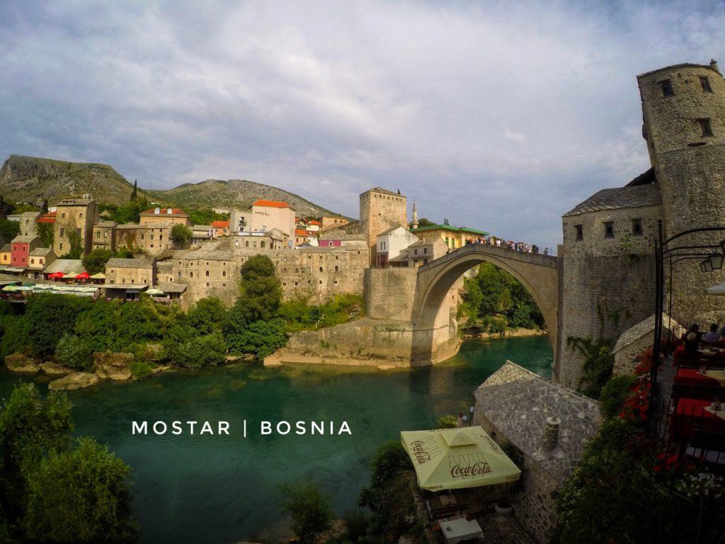 Grab a seat at a cafe along the Neretva river for beautiful views! And if you're lucky, you can watch the Mostar bridge jumpers from your table