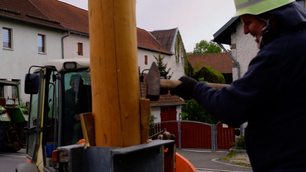 It takes a team of people to secure the Maibaum. No one wants a 30 meter Maypole falling over!