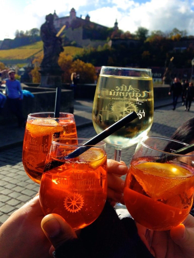 Treat yourself to an Aperol spritz or a glass of wine while strolling across the Würzburg bridge!
