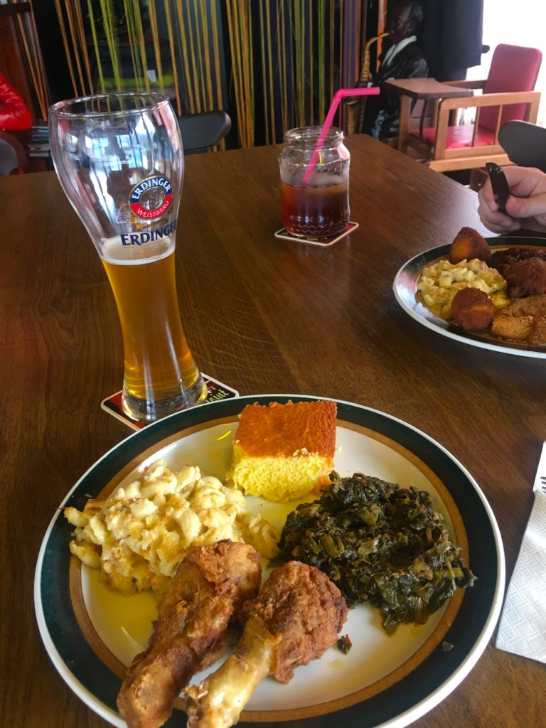 Fried chicken, mac and cheese, greens, and cornbread at Angelos soul food restaurant