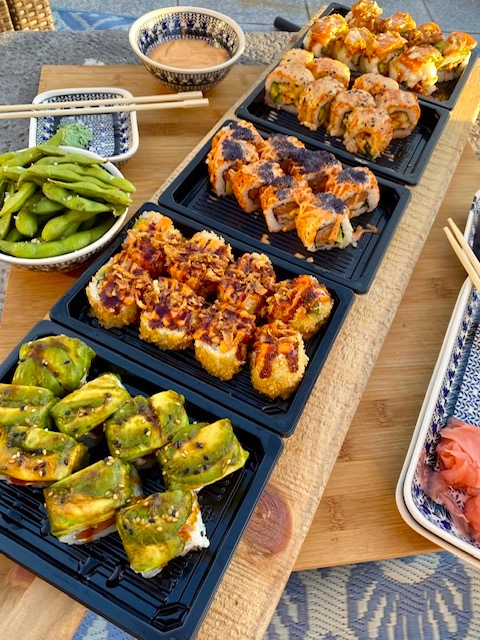 Enjoy sushi dinner plate and edamame appetizer