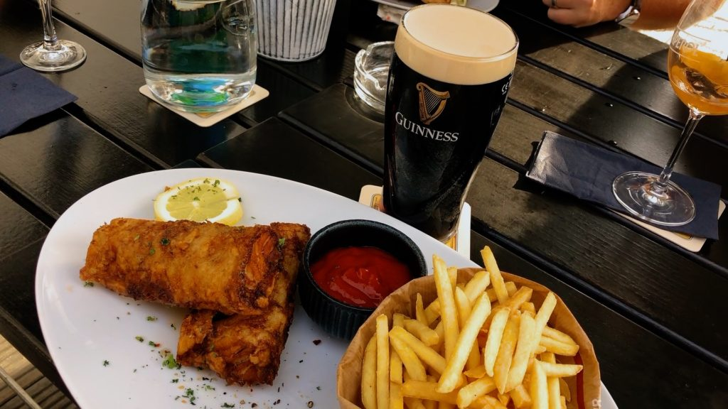 Fish and chips with a cold Guinness from the Irish Pub