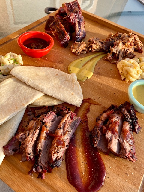 Brisket, ribs, gravy, mac and cheese, get it all from Louis Austin BBQ smokehouse food truck