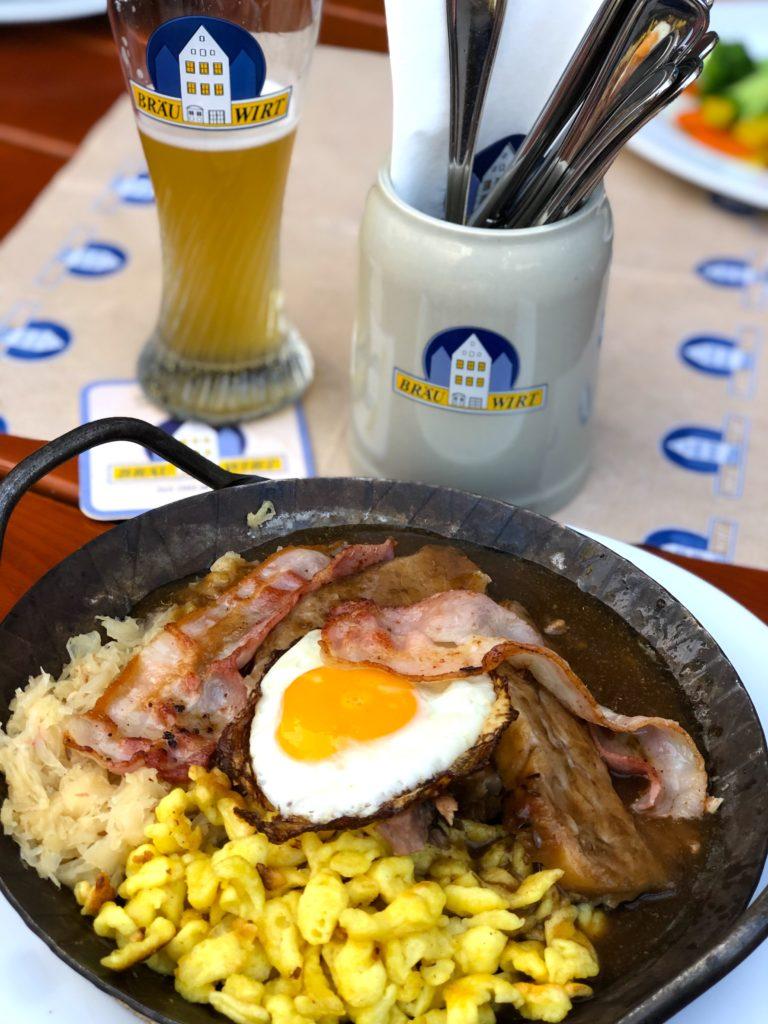 Braumeister Pfandl- pork with fried egg, bacon, butter spätzle, and sauerkraut at Bräu Wirt