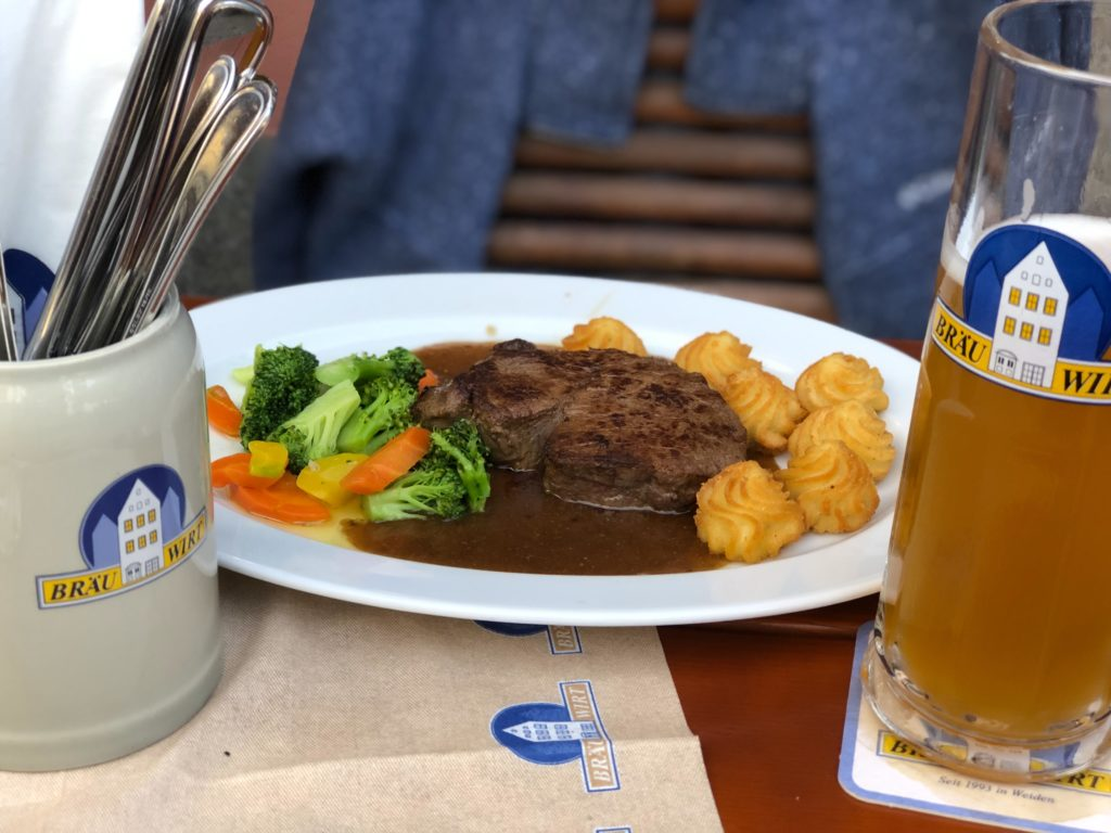 Steak, vegetables, and potatoes at Bräu Wirt