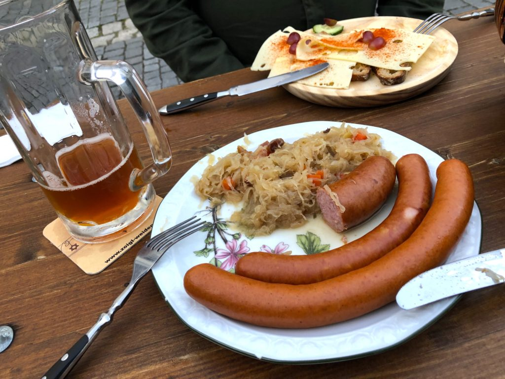 Three wurst sausage plate, bacon sauerkraut, bread and cheese at Kloine Zoigl Stub'n Zum Stich'n