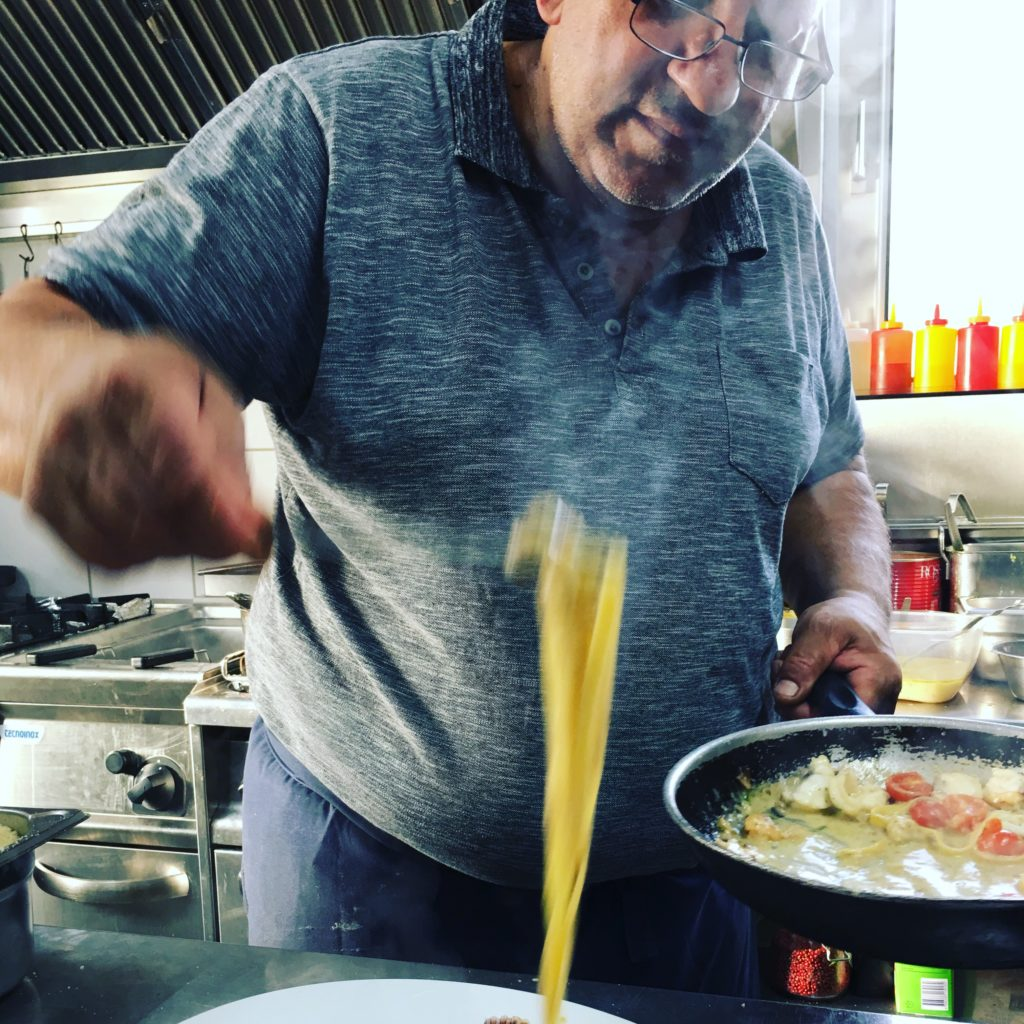 Family owned Weiden restaurants: Trattoria Bologna chef preparing a pasta dish