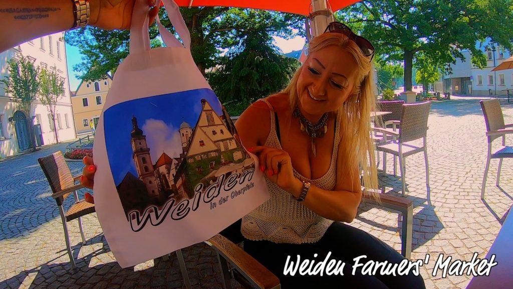 Local weiden woman receives a custom weiden shopping bag for the weiden farmers market