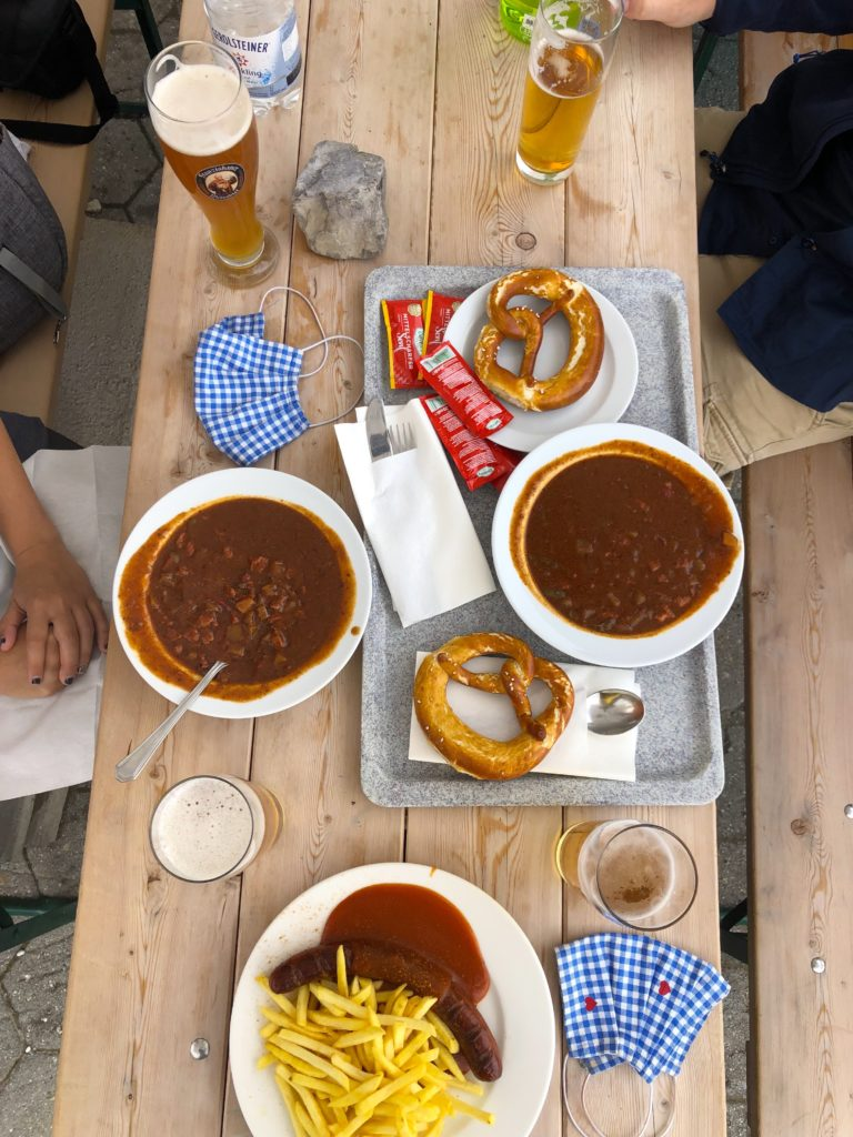 Goulash soup, currywurst with fries, pretzels, and beer at restaurant alpspitz