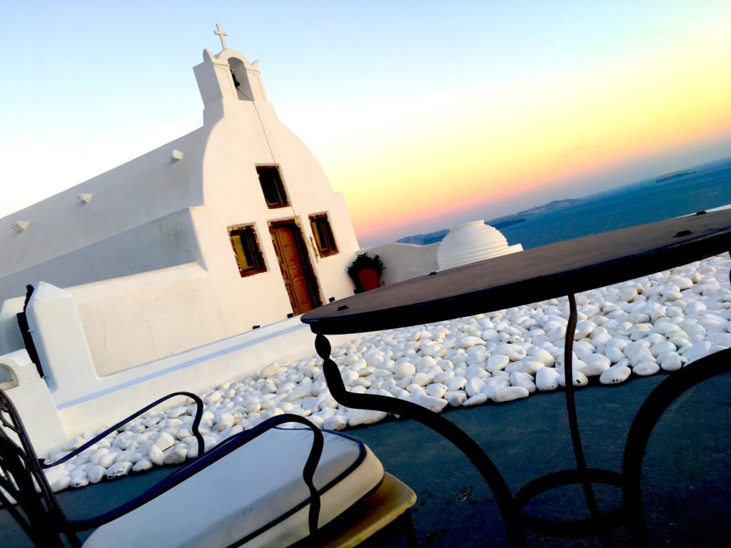 Sitting on a patio in Oia watching the Santorini sunset