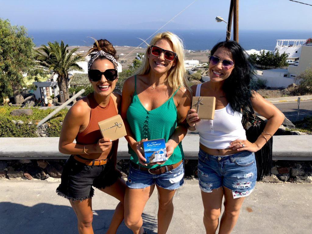 Girls with Santorini souvenirs & gifts from locals