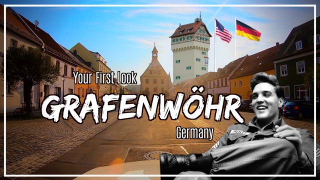 Your first look at Grafenwoehr photo in front of the Grafenwoehr Rathaus, water tower, US and German flag and Elvis Presley