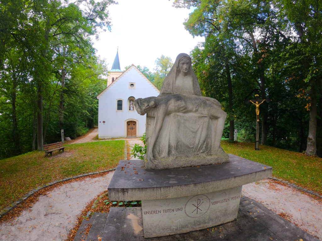 Small church and statue memorial in Grafenwoehr for lives lost during World War 2
