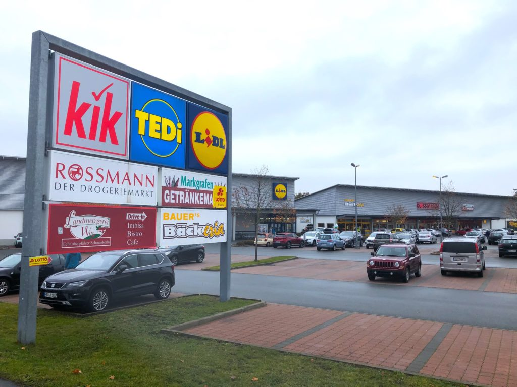 Various business signs in the Grafenwoehr shopping center