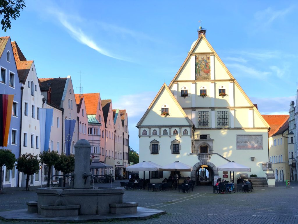 Old city hall, fountains, and colorful buildings in downtown Weiden Germany