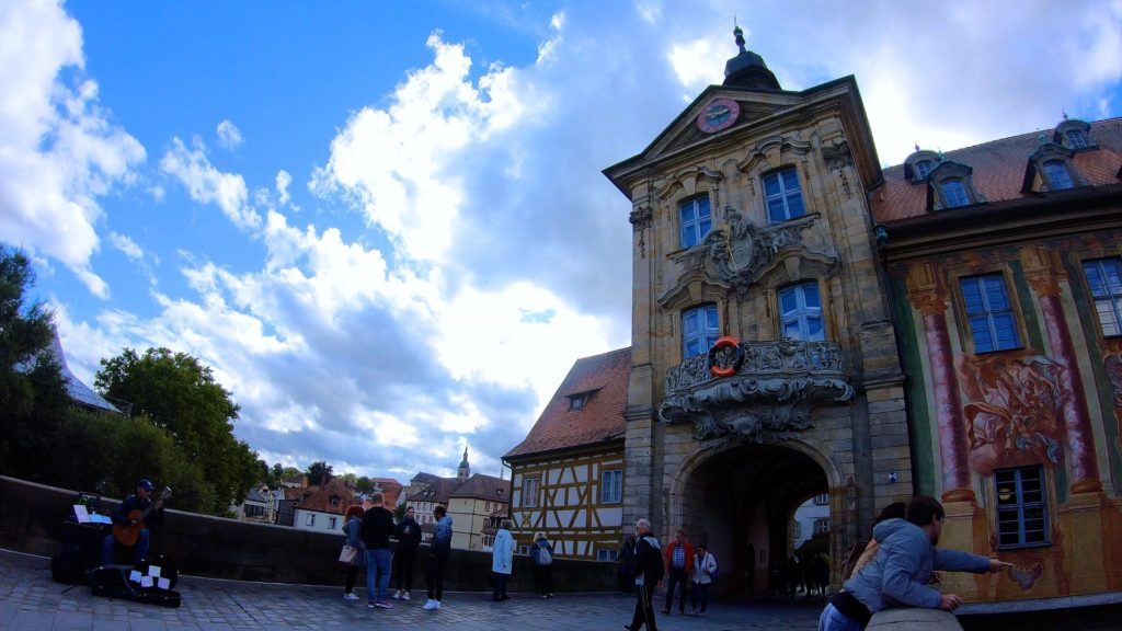 One of the most popular things to do in Bamberg, people watching on the old rathaus bridge