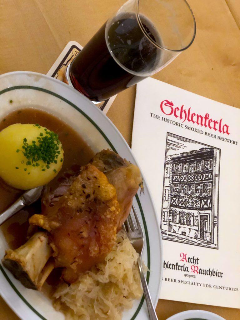 Pork knuckle, potato and smoke beer at schlenkerla restaurant in Bamberg Germany