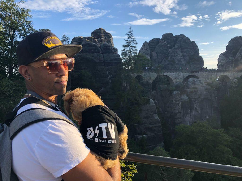 overlook of bastei bridge with dog