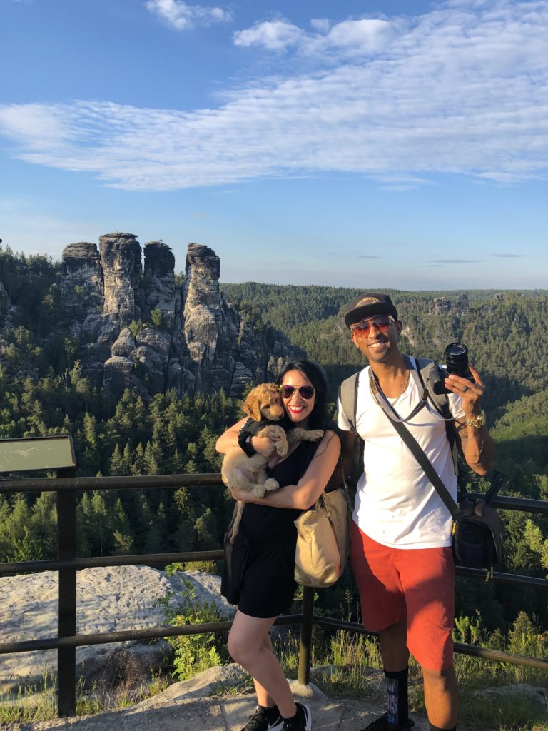taking a picture in front of rock formation at bastei bridge